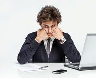 Depressed businessman dissatisfied with his earnings Royalty Free Stock Photo