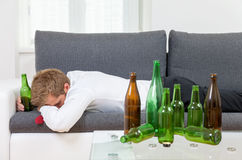 Depressed businessman drunk at home Royalty Free Stock Photos