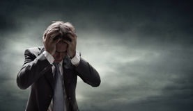 Depressed Businessman With Grunge Cloudscape stock photos