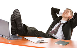 Depressed businessman with legs on table Royalty Free Stock Photos