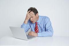 Depressed Businessman Looking At Laptop Royalty Free Stock Images