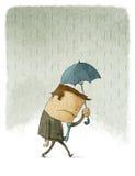 Depressed businessman and rain Stock Photography