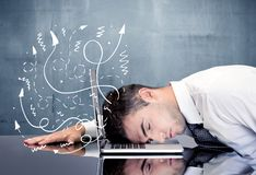 Business person with frustrated thoughts. A depressed businessman resting his head on a keyboard and shouting with illustration of ideas, arrows, lines leaving royalty free stock photography