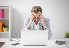 Depressed businessman sitting at computer Royalty Free Stock Photo