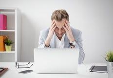 Depressed businessman sitting at computer Royalty Free Stock Photo