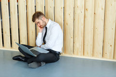 Depressed Businessman sitting on floor at his office. Hard work Royalty Free Stock Photo