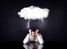 Depressed businessman sitting under a cloud royalty free stock images
