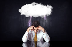 Depressed businessman sitting under a cloud Royalty Free Stock Photos