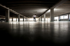 Depressed Businessman In Undeground Parking Stock Photos