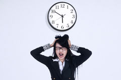 Depressed businesswoman with a clock Royalty Free Stock Photo