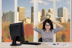 Depressed businesswoman with declining graph Stock Image