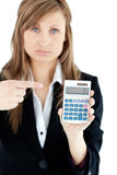 Depressed businesswoman holidng a calculator Stock Photography