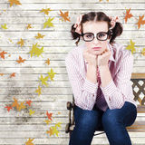 Depressed businesswoman In A Networking Crisis. Sad Introvert Businesswoman Sulking In A State Of Depression While Sitting On An Autumn Park Bench Outdoors In A Stock Photos