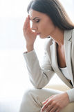 Depressed businesswoman. Royalty Free Stock Image
