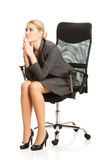 Depressed businesswoman sitting on armchair Royalty Free Stock Photography