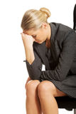 Depressed businesswoman sitting on armchair Stock Images