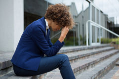Depressed businesswoman sitting in the premises. Depressed businesswoman sitting in the office premises Stock Images