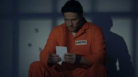 Depressed caucasian prisoner kissing photo, missing beloved, serving sentence. Stock footage stock footage