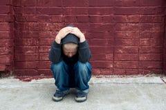 Depressed child Stock Images