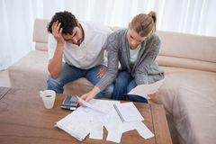 Depressed couple doing their accounting Royalty Free Stock Photos