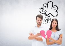 Depressed couple holding broken heart Stock Photography