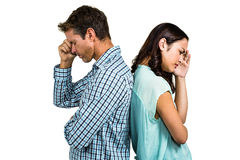 Depressed couple standing back to back Royalty Free Stock Image