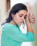 Depressed crying woman at home Stock Photo