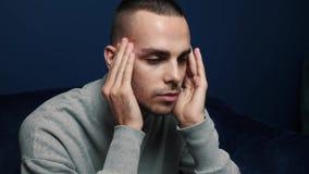 Depressed desperate man feeling worried . Stressed businessman looking frustrated sitting at home