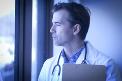 Depressed Doctor. At The Window Royalty Free Stock Photos