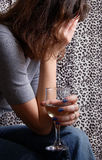 Depressed & drunk. Depressed woman with glass of wine. Camera: Nikon D50, 2 studio flashes Stock Image