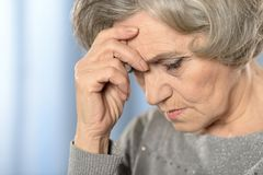 Depressed elderly woman Stock Images
