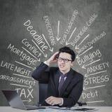 Depressed entrepreneur with work pressure Stock Image