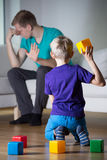 Depressed father ignores his son Royalty Free Stock Images