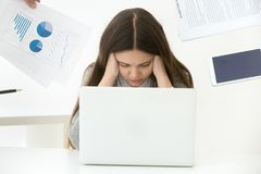 Depressed female worker feeling tired being annoyed by clients royalty free stock photos
