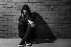Free Depressed Female Junkie Near Brick Wall. Concept Of Addiction Royalty Free Stock Photo - 151356375