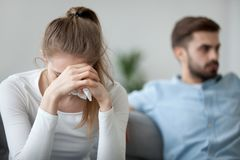 Unhappy wife tired of bad relationships, worried about problems concept. Depressed frustrated millennial women feeling offended and sad after fight with stubborn stock photo