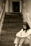 Depressed  girl. Black and white teen girl depressed on steps Stock Photography