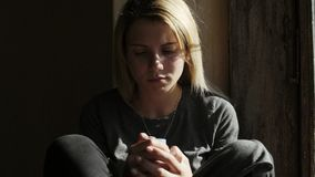 Depressed girl crying and holding pills.Close-up stock footage
