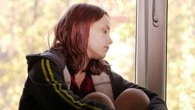 Depressed girl at home. Sad girl near window. stock footage