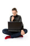 Depressed girl with laptop. Isolated on white background royalty free stock photo