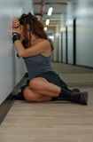 Depressed girl in a long corridor Stock Image