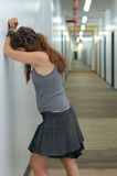 Depressed girl in a long corridor 2 Stock Photos