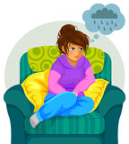 Depressed girl. Sad girl sitting on the sofa and thinking negative thoughts Royalty Free Stock Photo