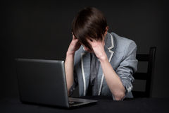 Depressed guy. Sitting in front of computer Royalty Free Stock Photos