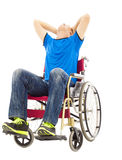 Depressed and handicapped man sitting on a wheelchair Royalty Free Stock Photo