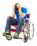 Depressed  and handicapped man sitting on a wheelchair Stock Photo