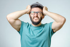 Depressed handsome bearded man touching having a headache Royalty Free Stock Photography