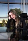 Depressed at her desk stock images