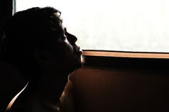 Depressed and hopeless man alone in the room Royalty Free Stock Image