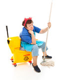 Depressed Housekeeper. Depressed maid sitting in her bucket and holding her mop, with a sad expression on her face.  Full body isolated Stock Photography